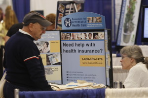 A CAHC staff member helps a consumer with his health coverage questions